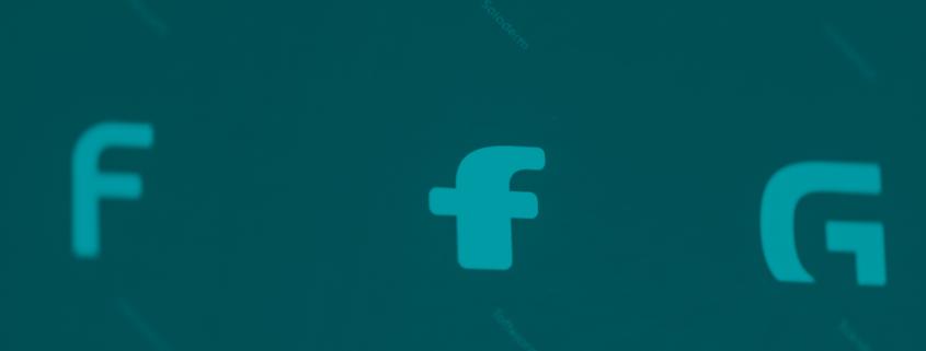 bogstaver med facebooks font i fokus