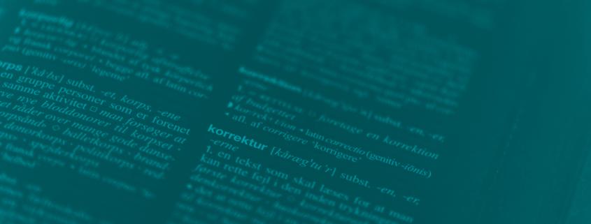 Blåt foto af ordet korrektur fra Politikens Nudansk med Etymologi